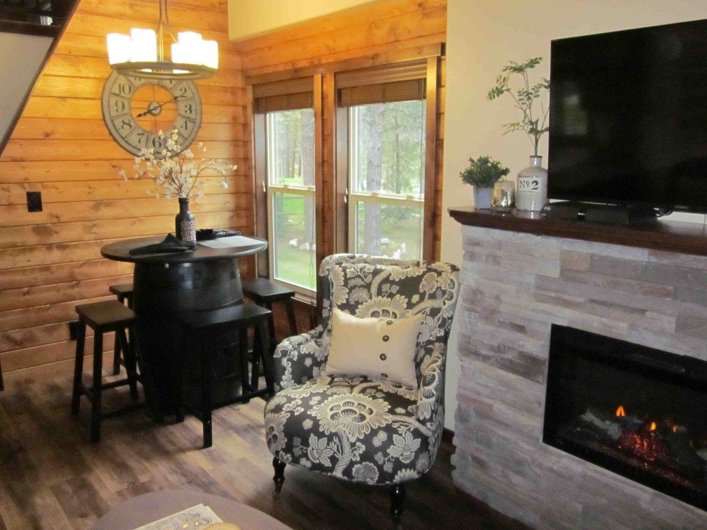 ... Unit That Reflect Optional Features Including The 24u2033 Eaves, Electric  Fireplace, Log Siding And Sliding Glass Door. The Furniture Is Not  Included.u201d
